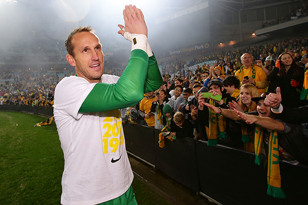 SYDNEY, AUSTRALIA - JUNE 18: Mark Schwarzer of the Socceroos celebrates with fans after the FIFA 2014 World Cup Asian Qualifier match between the Australian Socceroos and Iraq at ANZ Stadium on June 18, 2013 in Sydney, Australia. (Photo by Matt King/Getty Images)
